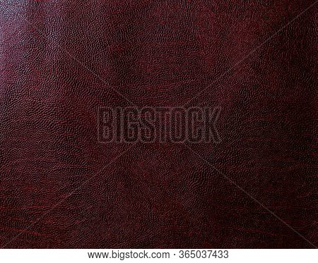 Maroon Faux Leather. Artificial Leather Texture Close Up