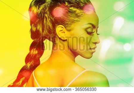 Beautiful woman with long braided hair, profile shot.