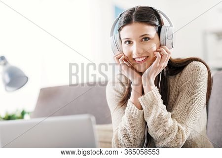 Woman At Home With Headphones