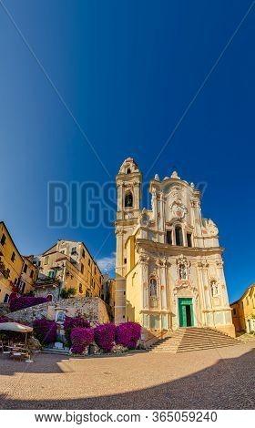 Cervo (imperia), Italy - 06 15 2015: The Cobblestone Square And Church (chiesa Di San Giovanni Batti