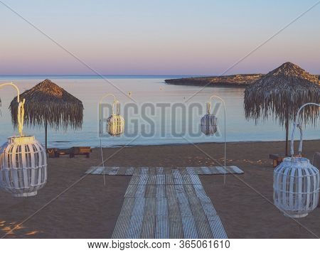 Photo Of Vacant Beach Shack Made Up Of Dried Palm Leaves On A Deserted Beach Of Island During Sunset
