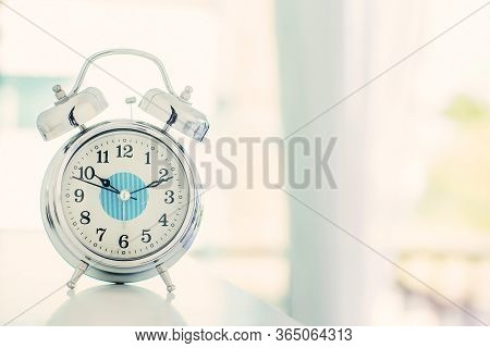 Focus White Alarm Clock Vintage Style With Blurry White Blackground In The Bedroom. Wake Up Maker, W