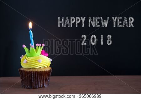 Cup Cake And Happy Newyear 2018  Text On Chalkboard Background..birthday Cupcake With A Single Blue