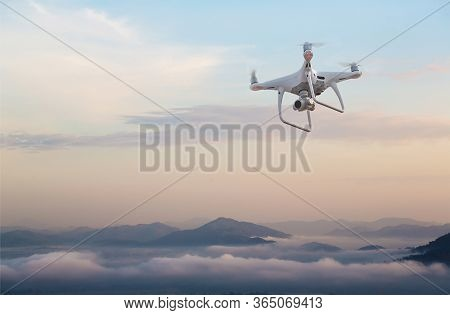Uav Drone Copter Flying With Digital Camera.drone With High Resolution Digital Camera. Flying Camera