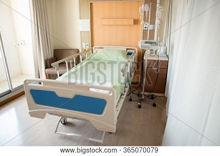 Empty Bed In The Modern Hospital Room. Deluxe Private Ward. Equipped Hospital Room. Medical Benefits