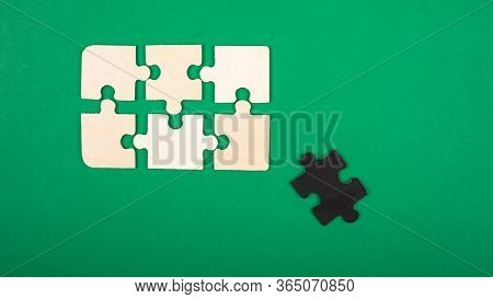 Pieces Of The Puzzle Colors White And Black, Lie On A Green Background. Outcast Antisocial White Cro