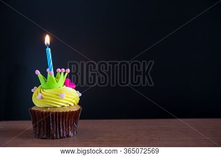 Birthday Cupcake With A Single Blue Candle.cupcake With Yellow Cream And Heart For Love Valentines.g