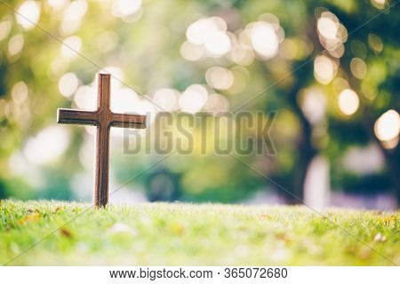 The Cross Standing On Meadow Sunset And Bokeh Background.cross On A Hill As The Morning Sun Comes Up