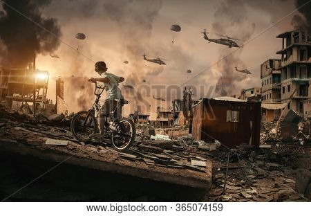Homeless Little Boy Watching Helicopters And Soldiers In Sky In Destroyed And Bombarded City Between