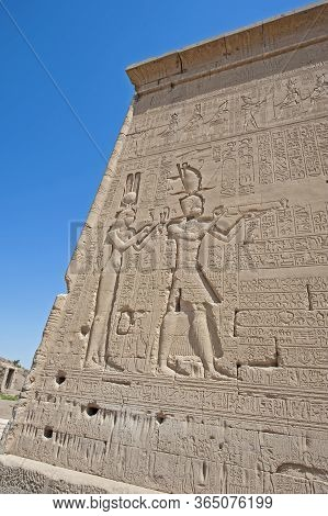 Hieroglypic Carvings On Wall At The Ancient Egyptian Temple Of Hathor In Dendera