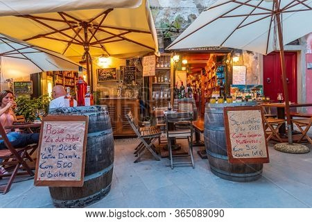 MONTEROSSO AL MARE, ITALY, MAY 20, 2018: TOURISTS AT STREET RESTAURANTS AT NIGHT IN THE CENTRE OF MONTEROSSO