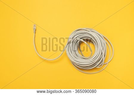 Closeup Network Internet Cable Hank Rj45 On Yellow Background. Concept, Flat Lay.