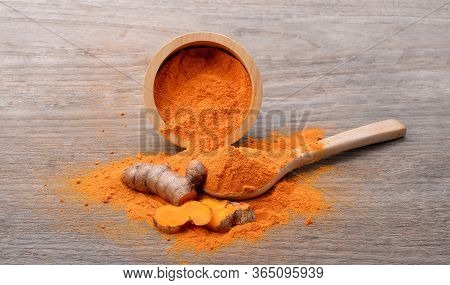 Turmeric Powder And Turmeric Root  On Wood ,turmeric Is Herb.