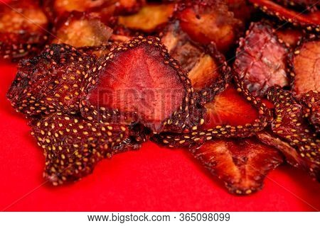 Chips From Dried Strawberries, Sliced Into Thin Slices. Background For Healthy Eating And Vegetarian