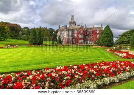 Adare gardens and castle in red ivy in Ireland