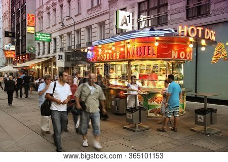 Vienna, Austria - September 4, 2011: People Visit Hot Dog And Noodle Bar In Vienna. Vienna Is The 17