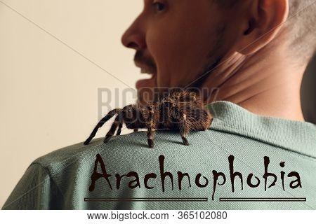 Scared Man With Tarantula On Beige Background, Closeup. Arachnophobia (fear Of Spiders)