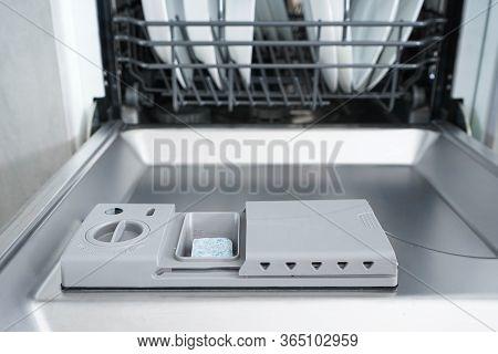 Full Dishwasher, Focus On Dishwasher Detergent Tablet, Close-up.