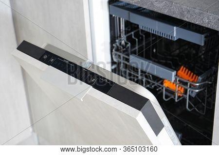 Opening The Dishwasher. Washing Dishes In The Dishwasher.