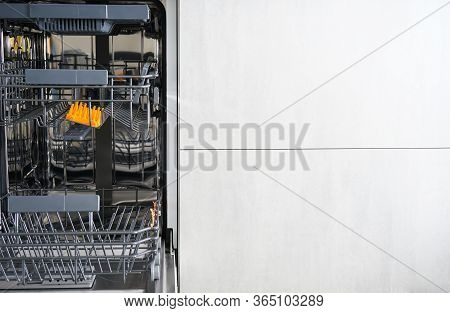 Washing Dishes In The Dishwasher. An Open, Empty Dishwasher With Meta For Text.