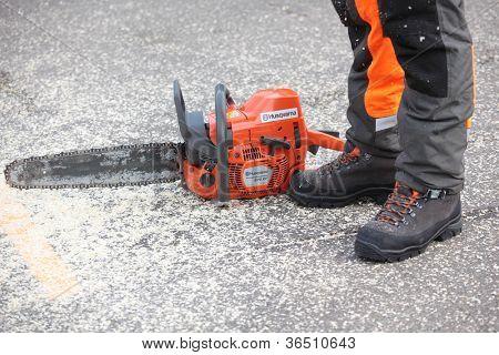 RAUBICHI, BELARUS - AUGUST 25: Chainsaw on the ground after bucking during World Logging Championship in Raubichi, Minsk region, Belarus at August 25, 2012