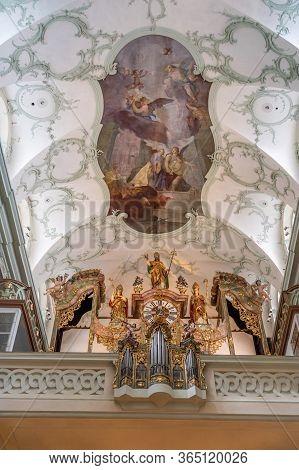 Feb 4, 2020 - Salzburg, Austria: Golden Clock Under Rococo Style Ceiling Inside St Peter Abbey Churc