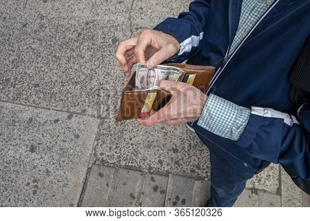 Looking Down At A Man Ready To Make A Making Cash Payment With Us Cash Currency Money Twenty Dollar