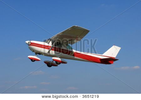Small Cessna 150 airplane taking off for a training flight poster