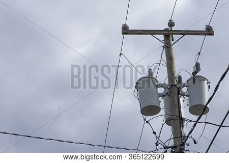 Utility Pole Supporting Wires For Electrical Power Distribution, Coaxial Cable For Cable Television,