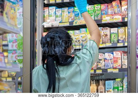 Bangkok, Thailand - May 07: Unnamed Convenient Store Staff Organizes Inventory In The Refrigerator I