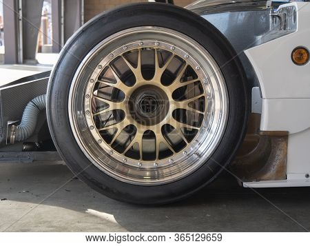 Close Up View Of Race Car Wheel And Tire