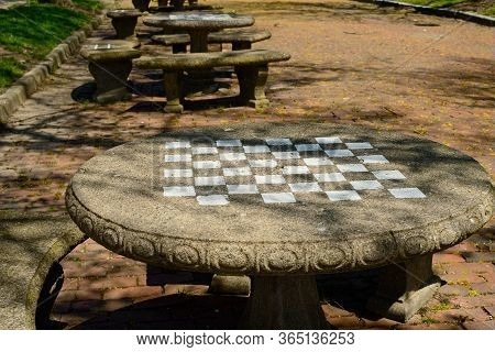 A Stone Table With A Checkerboard Painted On Its Surface Stands On A Brick Street In An Ohio Town, W