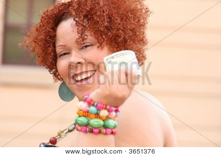 Woman With Red Curly Hair Holding Money