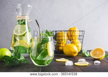 Detox Water Or Lemonade With Lemon Mint, Citrics In Glass On Grey Background.