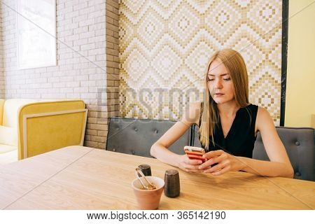 Beautiful blond  woman with long natural hair in cafe