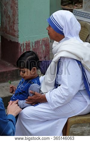 CHUNAKHALI, INDIA - FEBRUARY 26, 2020: Missionaries of Charity - Mother Teresa nun with child in Chunakhali, West Bengal, India