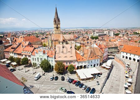 Historical architecture Lutheran cathedral church and tower and other old buildings around Piata Mica (Small square) in Sibiu, Transylvania, Romania . poster