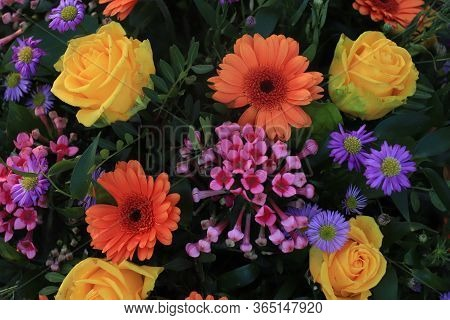Colorful Bridal Flower Arrangement: Orange Gerberas, Yellow Roses And Purple Asters
