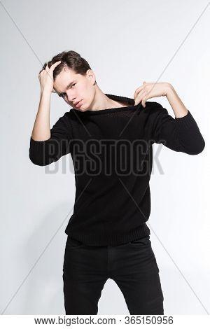 Handsome Fashion Man In Black Sweatshirt Posing On White Background. Model Test. Mock-up Sweatshirt.