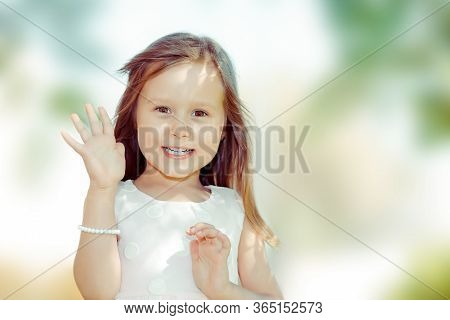 Hi Dear, Greeting Someone. Happy Smiling Woman Waving Hand Waving Over Shoulder Looking Away To A Fr