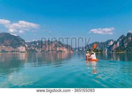 Mother With Son Together Floating On Kayak By The Cheow Lan Lake In Exotic Thailand. Traveling With