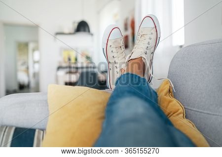 Young Female Lying In New Beige Sneaker Son Cozy Comfortable Living Room Sofa Putting Feet On Pillow
