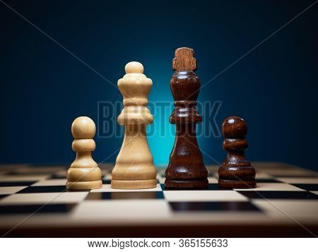 Multiracial Family And Diversity Concept. King, Queen And Two Pawns.