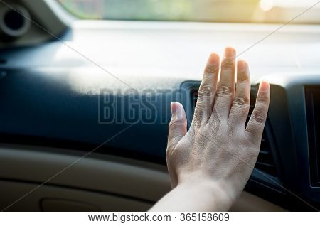 Closeup Of Hand Woman Checking Flow Cold From Air Conditioner In New Car,cooling System In Car,auto