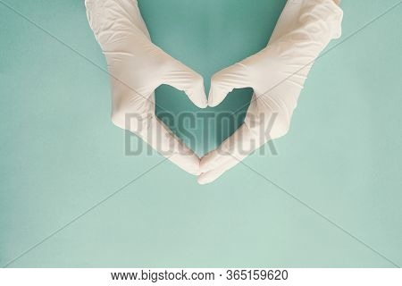 Doctor Hands With Medical Gloves Making Heart Shape, Health Insurance, Donation, Charity During Covi