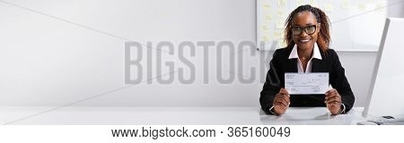 African American Boss Holding Paycheck Or Payroll Check
