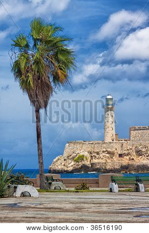 Vertical view of the castle of El Morro, a symbol of Havana, and a nearby romantic park on a day with a beautiful sky