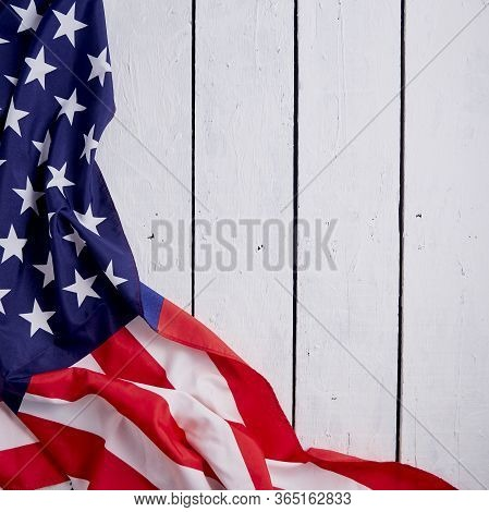American Flag For The America's 4th Of July Celebration Over A White Wooden Rustic Background To Mar
