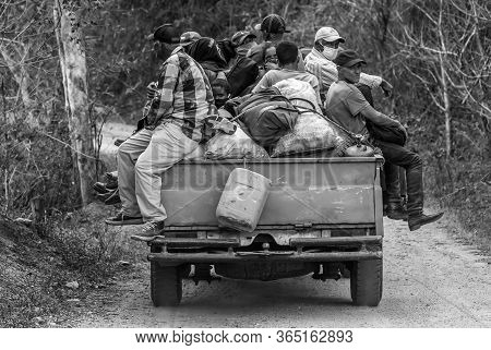 May 2, 2020 Ocoa, Dominican Republic. Dramatic Black And White Image Of Dominicans Ridding A Truck H