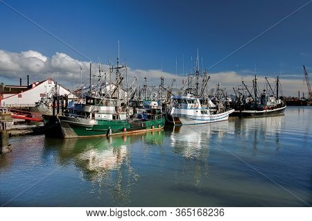 Fishing Boats In Marina And A Cloudy Sky. This Marina Is Located In The Stevestone Area Of Richmond.